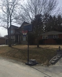 My basketball hoop. It is not the best net in the world, but it gets the job done. I come outside and shoot around just to relax, it is like a stress reliever. Whether I had a long day at school or have some free time, if the weather is nice I am outside on my street shooting my basketball.