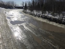 Our roads are an issue in Pikangikum. The roads are made of dirt, sand, gravel and rocks. We don't have paved roads at all. During spring time, as the snow thaws, the road becomes riddled with pot-holes. In the summer when the weather's more dry, the sand turns into dust clouds whenever a vehicle drives by. The road keeps getting worse and worse with each spring. The potholes damage our vehicles, which is why most people drive bigger vehicles like trucks and vans. Once a part of the road sunk under water, which went as deep as my knees. Paving roads now will, in the long term, save people a lot more money.